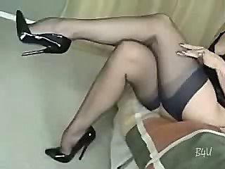 Mature in hot stockings sucks on cock