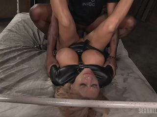 busty blonde in latex gets dominated by a bbc