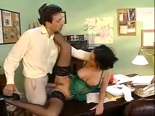 Sexy brunette gives a colleague