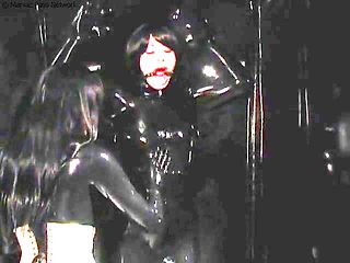 Latex Rubber Mistress and a Slave in Vacbed