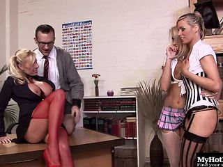 Group lesbian session in the classroom spiced up with a boner
