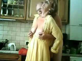 Se mum and dad having fun in the kitchen. Stolen video
