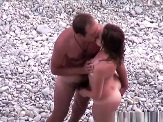Nudist couple spied in rocky beach fucking