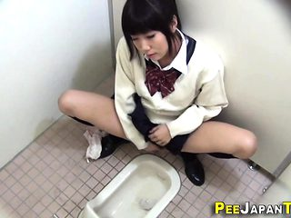 Teen asian pees in toilet