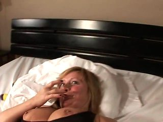 housewife playing with herself on bed