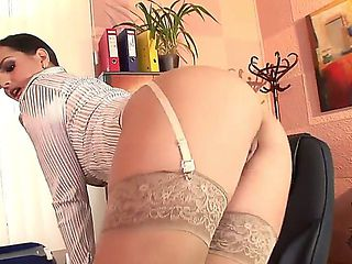 The prepossessing brunette pornstar Eve Angel in a stockings masturbates her pussy in a office