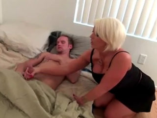 Busty Blond Gives Him A Morning Handjob