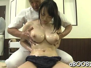 Oriental model with large tits goes wild on 2 large dongs