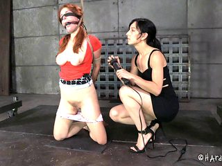 Redhead slaved lesbian with hot ass in bondage yelling while being worked on using sex machine in...
