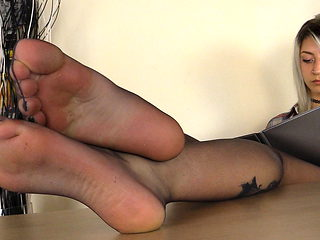 Under the table of a Blonde secretary in Pantyhose