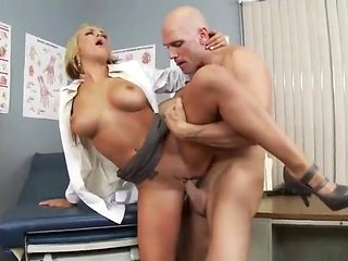 Divine blond Briana Blair performing a medical examination at workplace