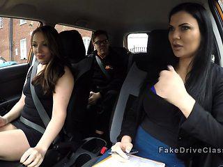 Threesome sex in fake driving school car