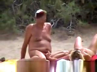 Nude couples on beach