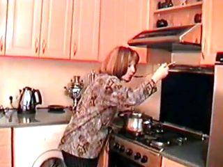 Mom angela with her boy in kitchen.