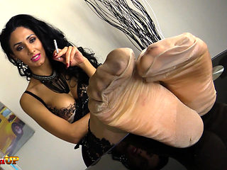 Mistress Alexya smokes a cig with her feet in stockings