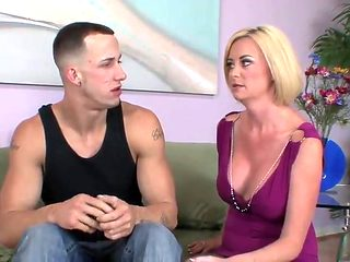 Blonde short haired milf cougar fucks on the sofa
