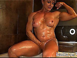 Female Bodybuilder Flexes And Washes Her Hard Muscles