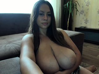 Stunning brunette MILF with BIG boobs teasing