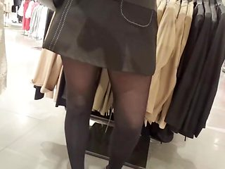 Shopper in shiny opaque black pantyhose and upskirt