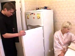 Russian mom nina with her boy in kitchen