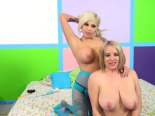 Blondes with massive titties take a pounding in the threesome