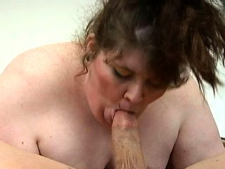 Fat bitch is bouncing on big dong of man after engulfing it