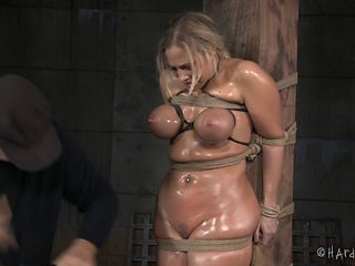 Voluptuous girl tied up in his dungeon gets oiled up