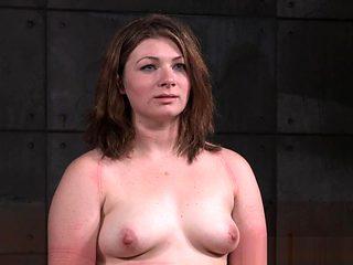 Restrained slave punished during BDSM fetish