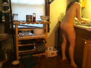NUDE SEXY  YOUNG GIRL IN THE KITCHEN