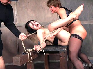 Lusty harlot gets banged by a horny couple in a BDSM threesome
