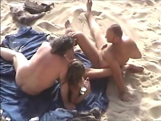 Couples sex at the beach