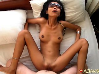 Skinny Cambodian honey offers her small mouth and pussy to