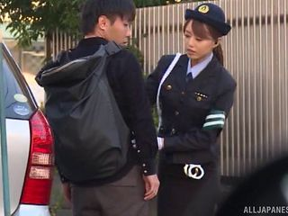 Japanese policewoman is ready to do some dick riding on the back seat