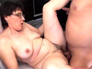Brunette mom sucks and fucks in the kitchen