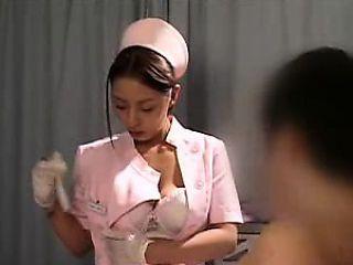 Delightful Asian nurse has a horny patient caressing her bi