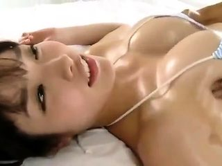 Busty Japanese plays with boobs