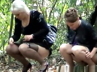 Four women caught by voyeur peeing outdoors