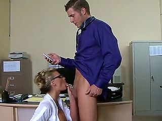 Busty blonde secretary with glasses Phoenix Marie gives her horny boss Chris Johnnson a hot blowj...