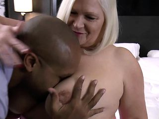 Big boobed grandma chokes on black cock