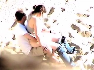 Horny brunette amateur getting her pussy fucked at the beach