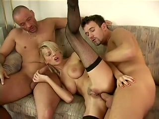 Slim blonde in black stockings Jasmine joins two hung studs for a wild threesome
