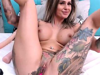 Amateur busty milf with tattooed big ass squirts on webcam
