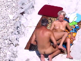 Nudist Couple Exposed By Voyeur Camera While Fucking On The Beach