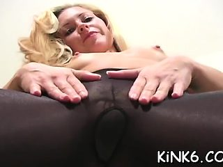 Solo girl fingers horny cum-hole through pantyhose