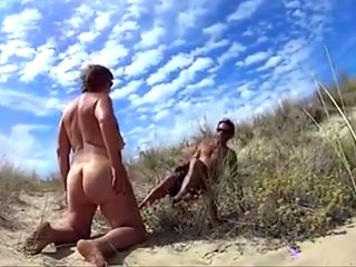 Swinger wife has sex with a stranger on the beach