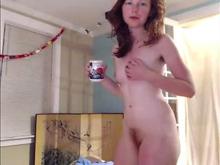 Cutie Red Head showing her body