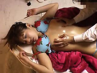 Asian cutie gets her slim body massaged and her hairy snatc