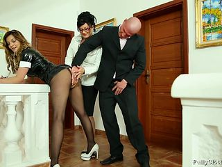 Slutty maid in a latex uniform gets fucked by a married couple