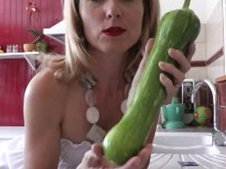 Blonde Puts A Large Veg In Her Vag
