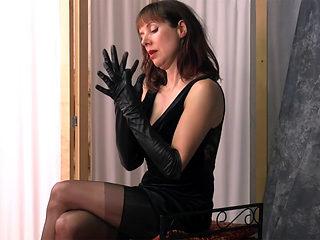 Posh british brunette Milf teases in nylons leather gloves